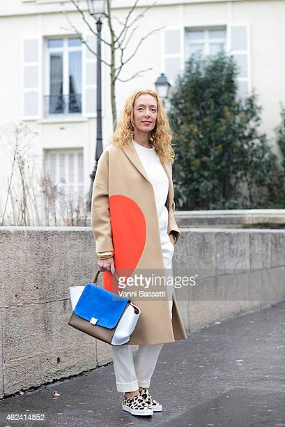 Elina Halimi poses wearing a MSGM coat and Celine bag and shoes during day 3 of Paris Haute Couture Spring Summer 2015 on January 28 2015 in Paris...