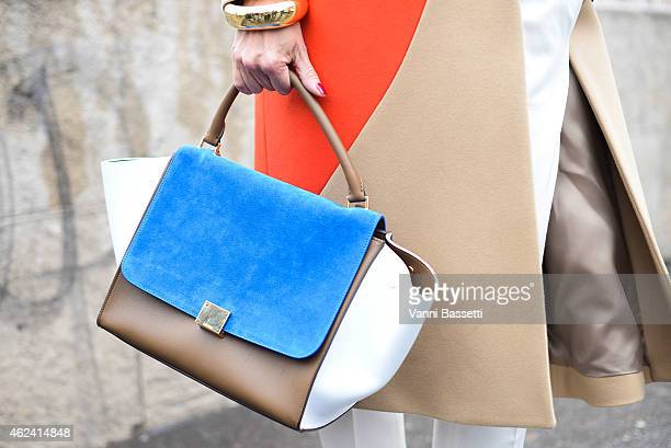 Elina Halimi poses wearing a MSGM coat and Celine bag during day 3 of Paris Haute Couture Spring Summer 2015 on January 28 2015 in Paris France