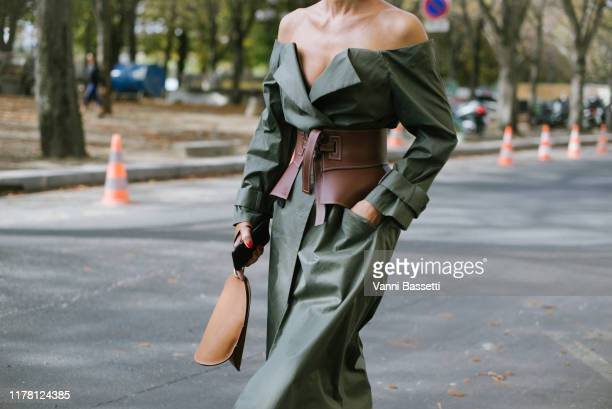 Elina Halimi poses with a Loewe belt after the Sacai show at the Grand Palais during Paris Fashion Week Womenswear Spring Summer 2020 on September 30...