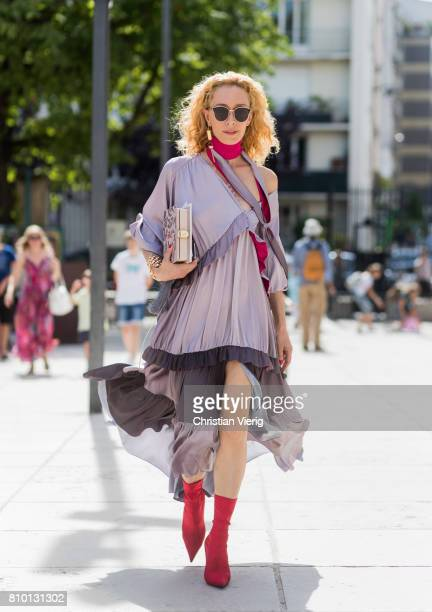 Elina Halimi wearing a dress outside Viktor Rolf during Paris Fashion Week Haute Couture Fall/Winter 20172018 Day Four on July 5 2017 in Paris France
