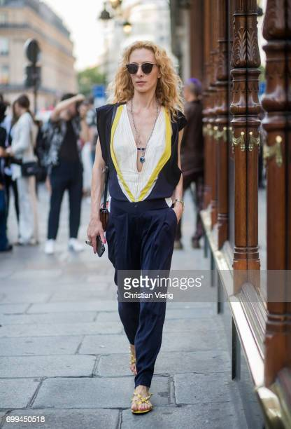 Elina Halimi wearing a navy jumpsuit outside Haider Ackermann during Paris Fashion Week Menswear Spring/Summer 2018 on June 21 2017 in Paris France