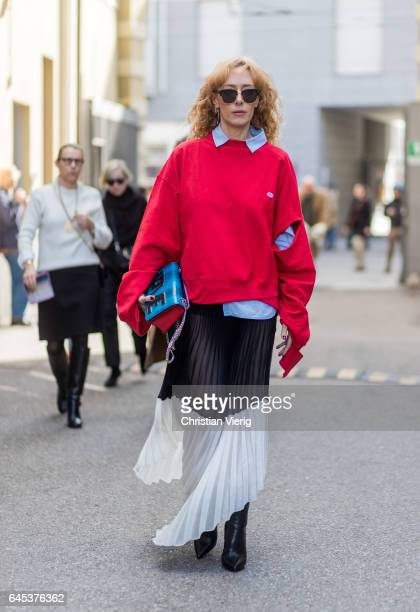 Elina Halimi wearing a red sweater button shirt black white skirt outside Missoni during Milan Fashion Week Fall/Winter 2017/18 on February 25 2017...