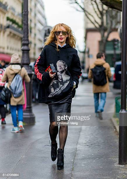 Elina Halimi wearing a Vetements hoody and a black leather skirt and Louis Vuitton bag outside Giambattista Valli during the Paris Fashion Week...