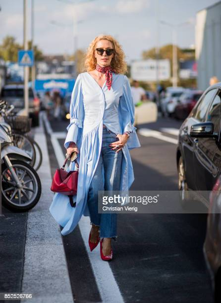 Elina Halimi wearing blue button dress is seen outside Missoni during Milan Fashion Week Spring/Summer 2018 on September 23 2017 in Milan Italy