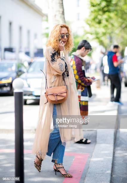 Elina Halimi wearing Loewe bag is seen outside Lanvin on day six of Paris Fashion Week Menswear SS19 on June 24 2018 in Paris France