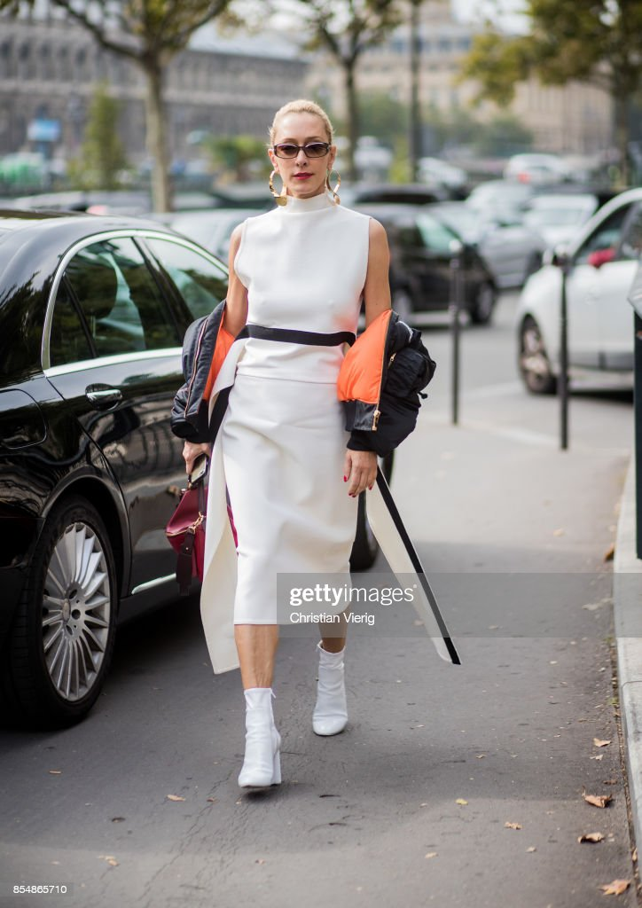 Elina Halimi wearing white dress, red Loewe bag is seen outside Dries van Noten during Paris Fashion Week Spring/Summer 2018 on September 27, 2017 in Paris, France.