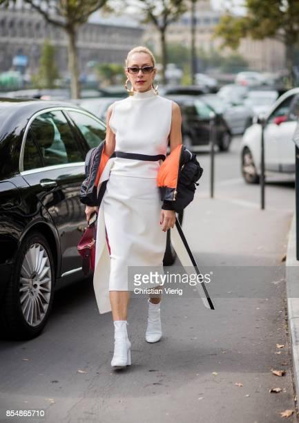 9b2c3df0e9900f Elina Halimi wearing white dress red Loewe bag is seen outside Dries van  Noten during Paris