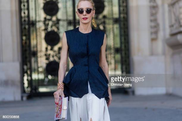 Elina Halimi wearing white skirt backless top outside Cerruti during Paris Fashion Week Menswear Spring/Summer 2018 on June 23 2017 in Paris France