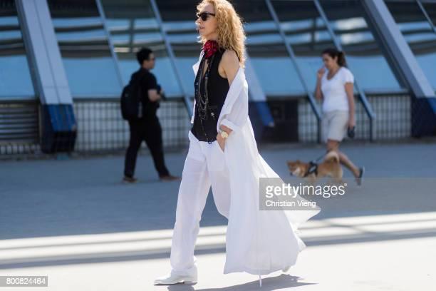 Elina Halimi wearing white wide leg pants outside Lanvin during Paris Fashion Week Menswear Spring/Summer 2018 Day Five on June 25 2017 in Paris...