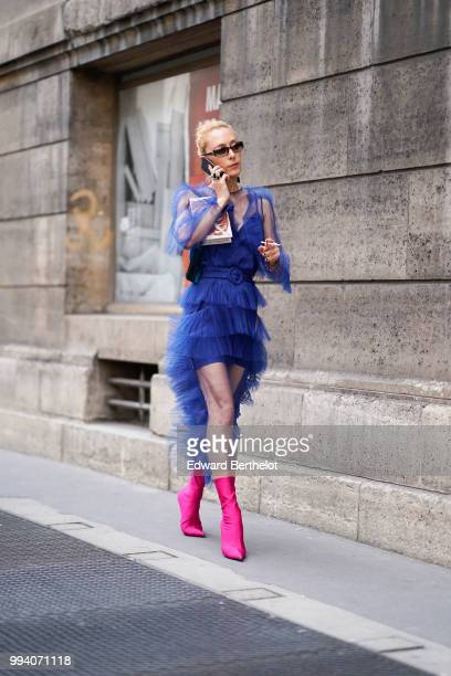 Elina Halimi wears a blue ruffled lace mesh dress sunglasses pink boots outside Elie Saab during Paris Fashion Week Haute Couture Fall Winter...