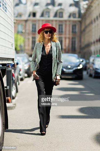 Elina Halimi wears a Saint Laurent Paris hat on June 24 2015 in Paris France