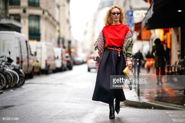 Elina Halimi wears sunglasses a scarf a red top a skirt a yellow Kill Bill clutch outside AF Vandervorst during Paris Fashion Week Haute Couture...
