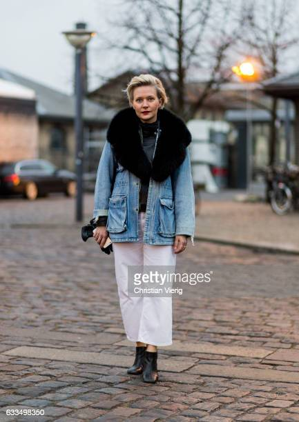 Elina Kaukonen wearing a denim jacket white wide leg pants black ankle boots fur scarf at the Copenhagen Fashion Week Autumn/Winter 17 on February 1...