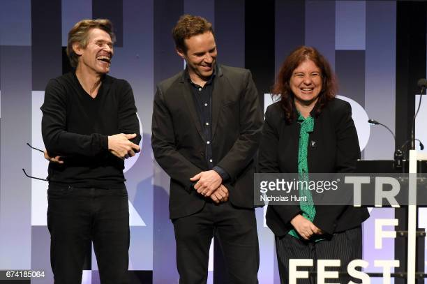 Elina Psykou accepts the Best International Narrative Feature Award from Jurors Willem Dafoe and Alessandro Nivola during Awards Night during the...