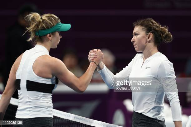 Elina Sitolina of Ukraine congratulates Simona Halep of Romania on her win in their WTA Qatar Open semifinal tennis match in Doha on February 15 2019
