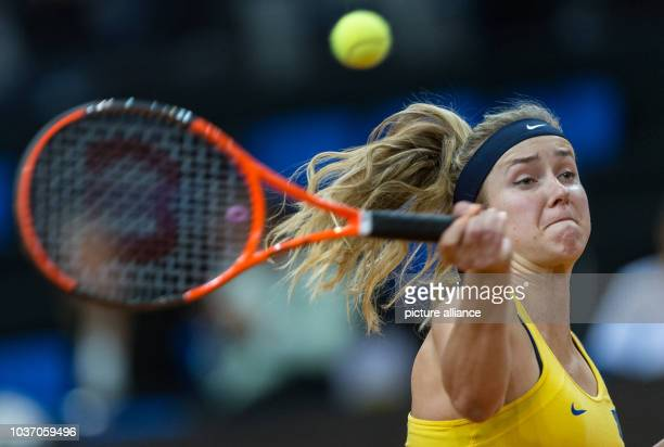 Elina Svitolina from Ukraine in action against Kerber from Germany at the Federation Cup world group relegation playoff round tennis match between...