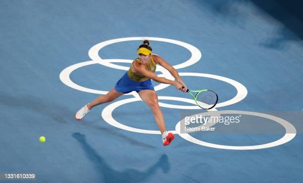 Elina Svitolina of Team Ukraine plays a backhand during her Women's Singles Bronze Medal match against Elena Rybakina of Team Kazakhstan on day eight...