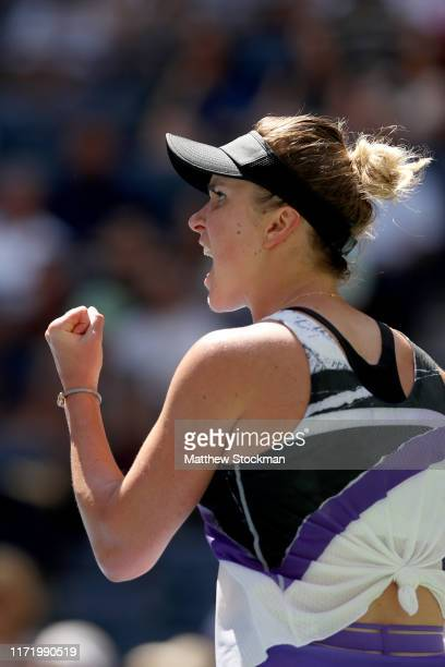 Elina Svitolina of the of the Ukraine celebrates a point during her Women's Singles quarterfinal match against Johanna Konta of Great Britain on day...