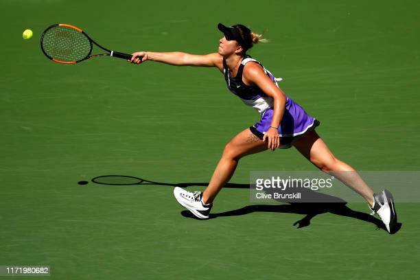 Elina Svitolina of the of the Ukraine returns a shot during her Women's Singles quarterfinal match against Johanna Konta of Great Britain on day nine...