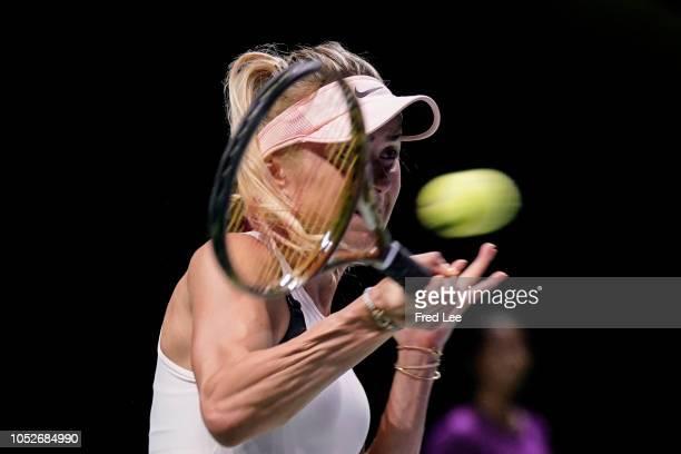 Elina Svitolina of the Ukraine hits a return against Petra Kvitova of the Czech Republic during day 1 of the BNP Paribas WTA Finals Singapore...