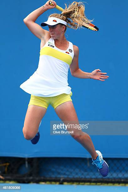 Elina Svitolina of the Ukraine plays a backhand in her first round match against Yulia Putintseva of Kazakhstan during day two of the 2015 Australian...