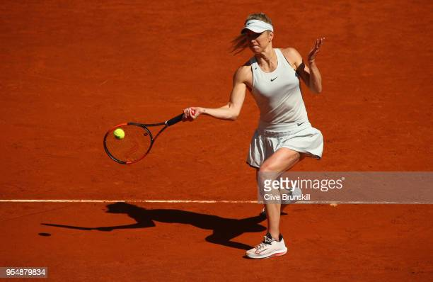 Elina Svitolina of the Ukraine plays a forehand against Alize Cornet of France in their first round match during day one of the Mutua Madrid Open...
