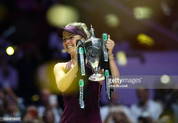 Elina Svitolina of the Ukraine poses with the Billie Jean King Trophy after her win against Sloane Stephens of the United States during the Women's...