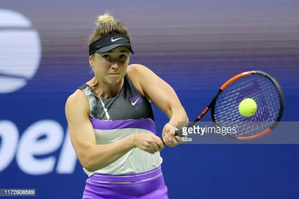 Elina Svitolina of the Ukraine returns a shot during her Women's Singles semi-final match against Serena Williams of the United States on day eleven...