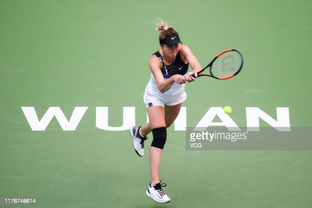 Elina Svitolina of the Ukraine returns a shot in the second round match against Garbine Muguruza of Spain on Day three of 2019 Dongfeng Motor Wuhan...