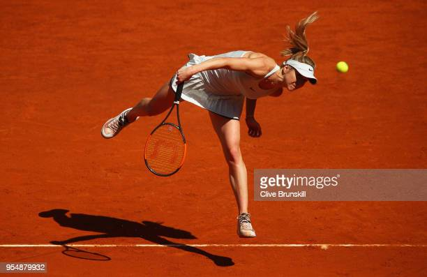 Elina Svitolina of the Ukraine serves against Alize Cornet of France in their first round match during day one of the Mutua Madrid Open tennis...