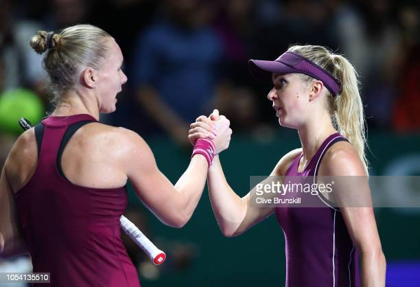 Elina Svitolina of the Ukraine shakes hands with Kiki Bertens of the Netherlands during the women's singles semi final match on Day 7 of the BNP...