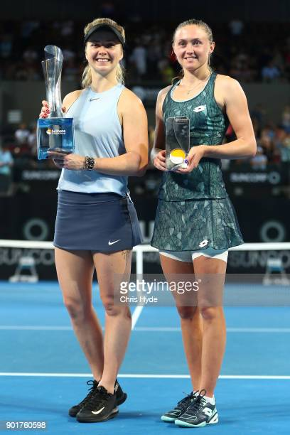 Elina Svitolina of Ukraine and Aliaksandra Sasnovich of Bulgaria hold the winners trophy after the Womens Final during day seven of the 2018 Brisbane...