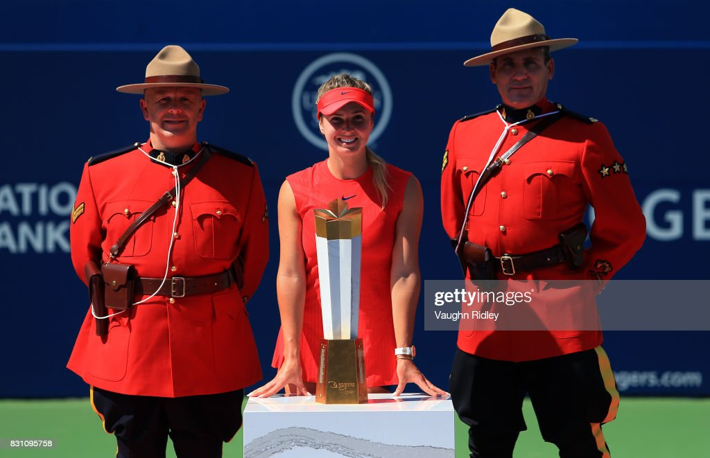 Elina Svitolina of Ukraine and Canadian Mounties with the winners trophy after defeating Caroline Wozniacki of Denmark following the final match on Day 9 of the Rogers Cup at Aviva Centre on August 13, 2017 in Toronto, Canada.