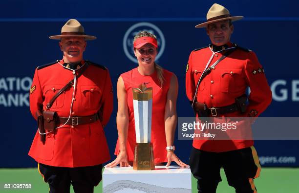 Elina Svitolina of Ukraine and Canadian Mounties with the winners trophy after defeating Caroline Wozniacki of Denmark following the final match on...