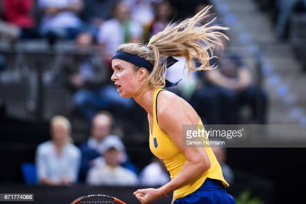 Elina Svitolina of Ukraine celebrates a point against Angelique Kerber of Germany during the FedCup World Group PlayOff match between Germany and...