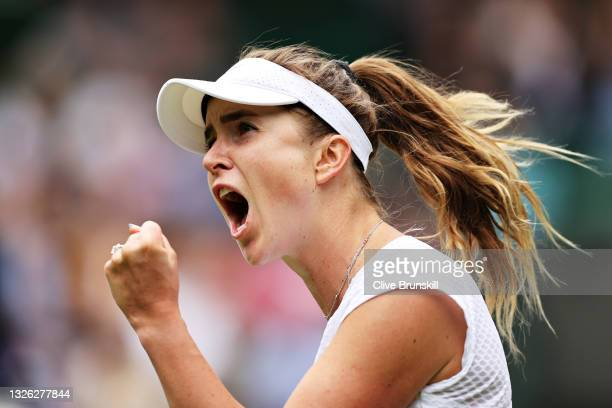 Elina Svitolina of Ukraine celebrates a point in her Ladies' Singles First Round match against Alison Van Uytvanck of Belgium during Day Three of The...