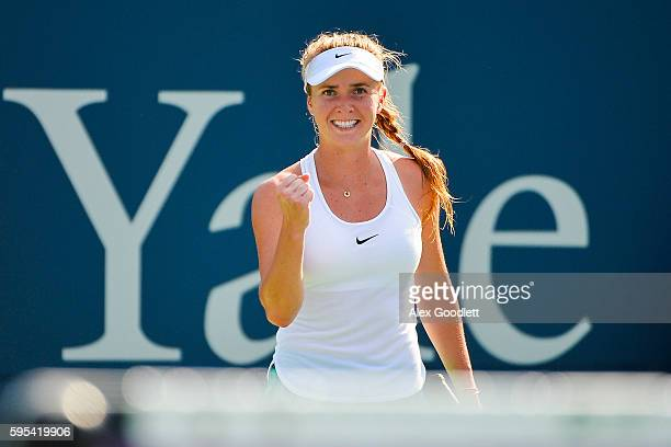 Elina Svitolina of Ukraine celebrates after defeating Elena Vesnina of Ukraine on day 5 of the Connecticut Open at the Connecticut Tennis Center at...