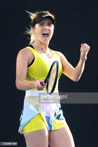 Elina Svitolina of Ukraine celebrates after winning match point during her Women's Singles first round match against Katie Boulter of Great Britain...
