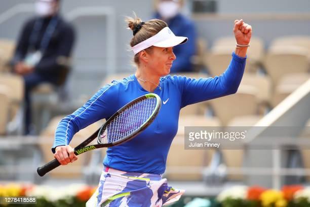 Elina Svitolina of Ukraine celebrates after winning match point during her Women's Singles fourth round match against Caroline Garcia of France on...
