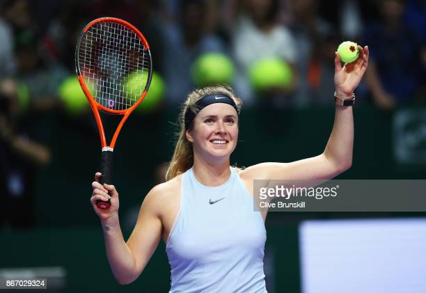 Elina Svitolina of Ukraine celebrates victory in her singles match against Simona Halep of Romania during day 6 of the BNP Paribas WTA Finals...