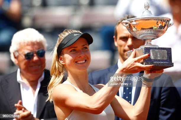 Elina Svitolina of Ukraine celebrates victory with the trophy after the Women's Singles final match between Simona Halep and Elina Svitolina on Day...