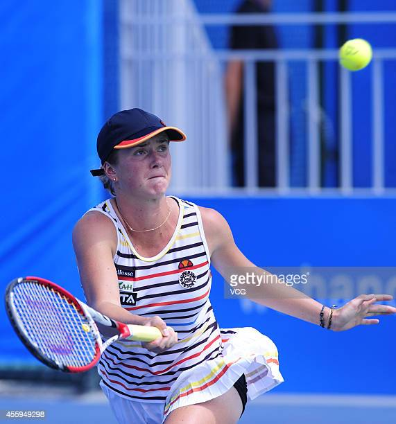Elina Svitolina of Ukraine competes with Sabine Lisicki of Germany during day three of the 2014 Dongfeng Motor Wuhan Open at Optics Valley...
