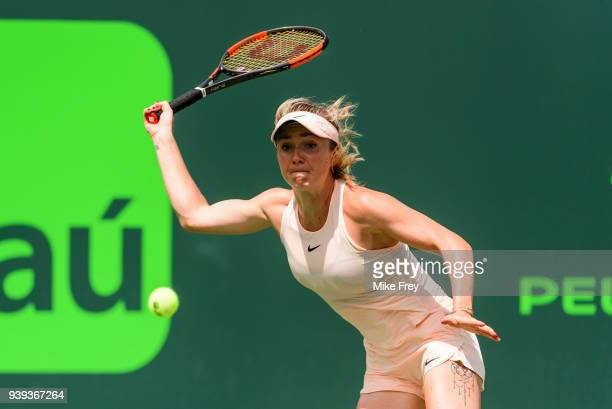 Elina Svitolina of Ukraine hits a forehand against Jelena Ostapenko of Latvia during the quarterfinals match on Day 10 of the Miami Open Presented by...