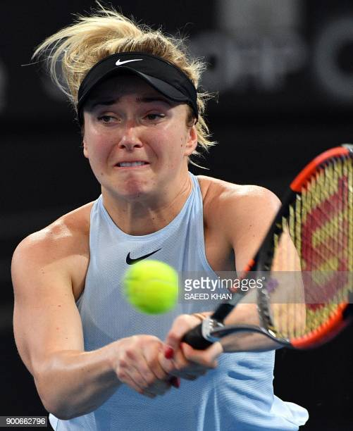 Elina Svitolina of Ukraine hits a return against Ana Konjuh of Croatia during their round of 16 match at the Brisbane International tennis tournament...
