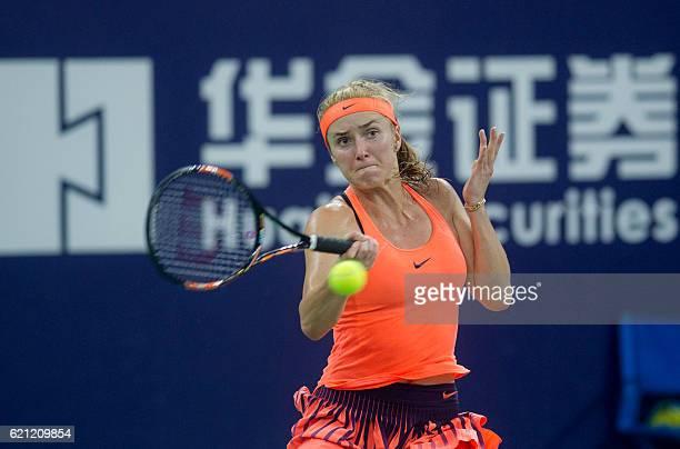 Elina Svitolina of Ukraine hits a return against Johanna Konta of Britain during their women's singles semifinal match at the WTA Elite Trophy tennis...