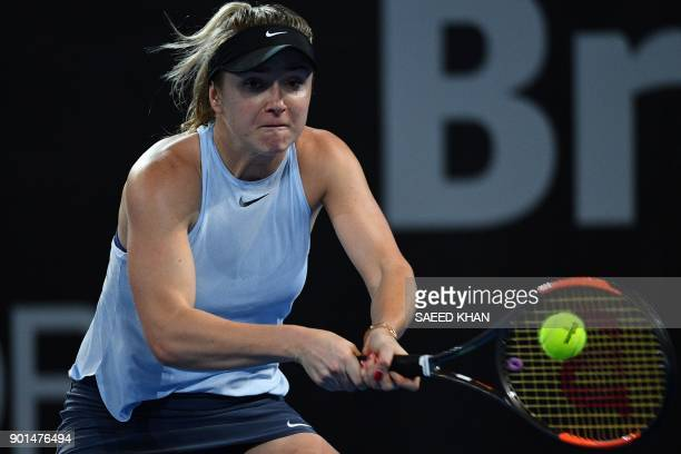Elina Svitolina of Ukraine hits a return against Karolina Pliskova of the Czech Republic during their women's singles semifinal match at the Brisbane...
