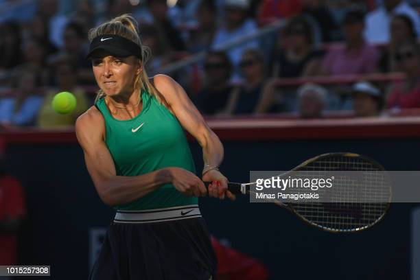 Elina Svitolina of Ukraine hits a return against Sloane Stephens during day six of the Rogers Cup at IGA Stadium on August 11 2018 in Montreal Quebec...