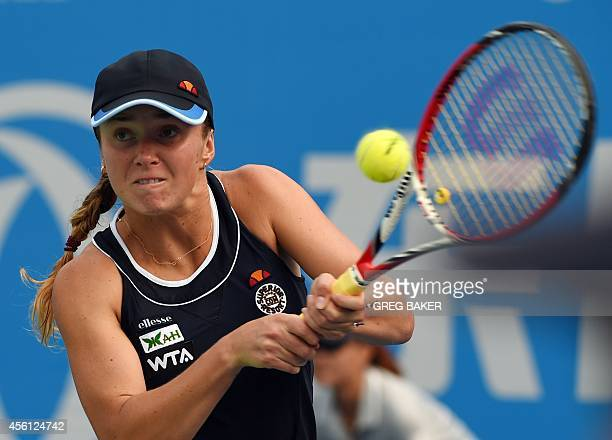 Elina Svitolina of Ukraine hits a return during her semifinal match against Petra Kvitova of the Czech Republic at the Wuhan Open tennis tournament...