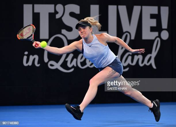 Elina Svitolina of Ukraine hits a return to Aliaksandra Sasnovich of Belarus during their women's singles final at the Brisbane International tennis...