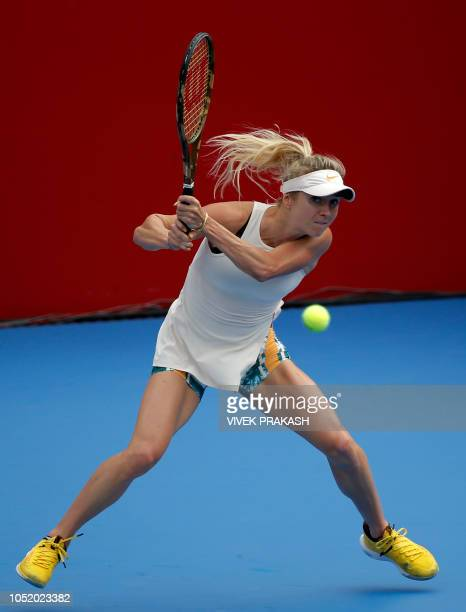 Elina Svitolina of Ukraine hits a return to Wang Qiang of China during her women's singles quarterfinal match at the Hong Kong Open tennis tournament...